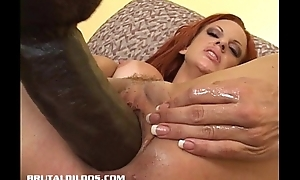 Busty redhead fills her Heraldry sinister pussy with a gigantic dildo