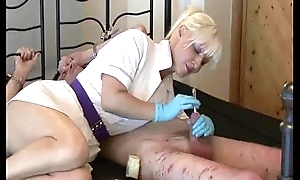 Mistress Nurse uses  sounds on her bound slave.