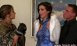 Femdom mistress rules over