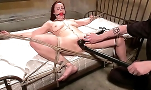 Redheads pussy controlled by polished whille tied to the bed