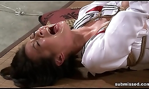 Oriental slave is hogtied, electro agonizing and dildo punished