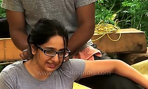 Dame receives sanative massage far Indian Himalaya.MP4
