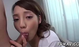 Marvelous asian enjoys rough fingering during three-some