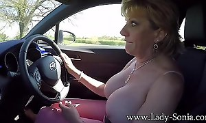 Mature flaxen-haired Daughter Sonia plays near the brush knockers space fully driving