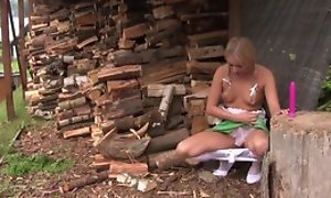 Pretty festival girl in cute dress plays alongside her coochie outdoors