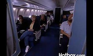 Juli Ashton copulates ginger linn in an airplane