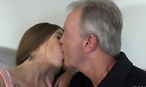 Sex-starved brunette satisfying old man on burnish apply sofa