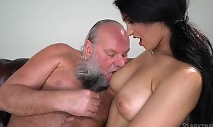 Handsome brunette close by big naturals fucks an grey man