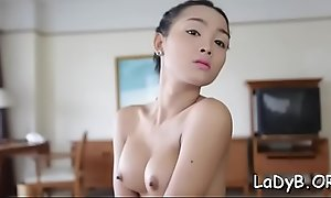 Breasty t-girl shows her body