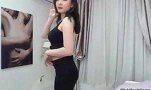 Busty microscopic Asian posing on cam