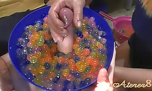 Young girl makes soft hanjob around tons of oil and water balls